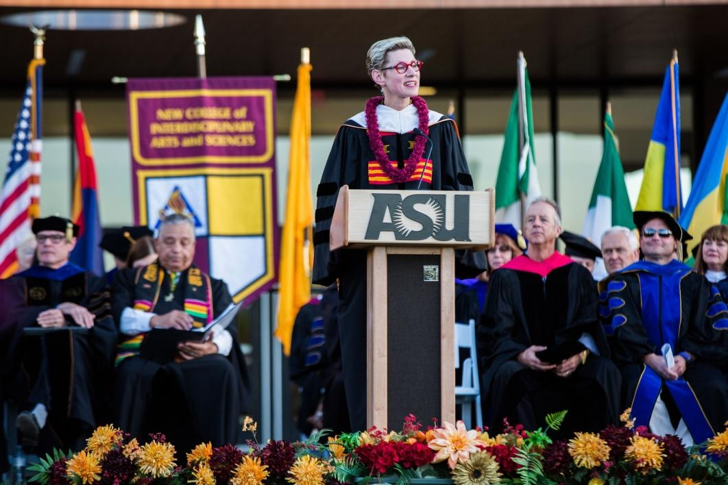 woman speaking at podium during convocation