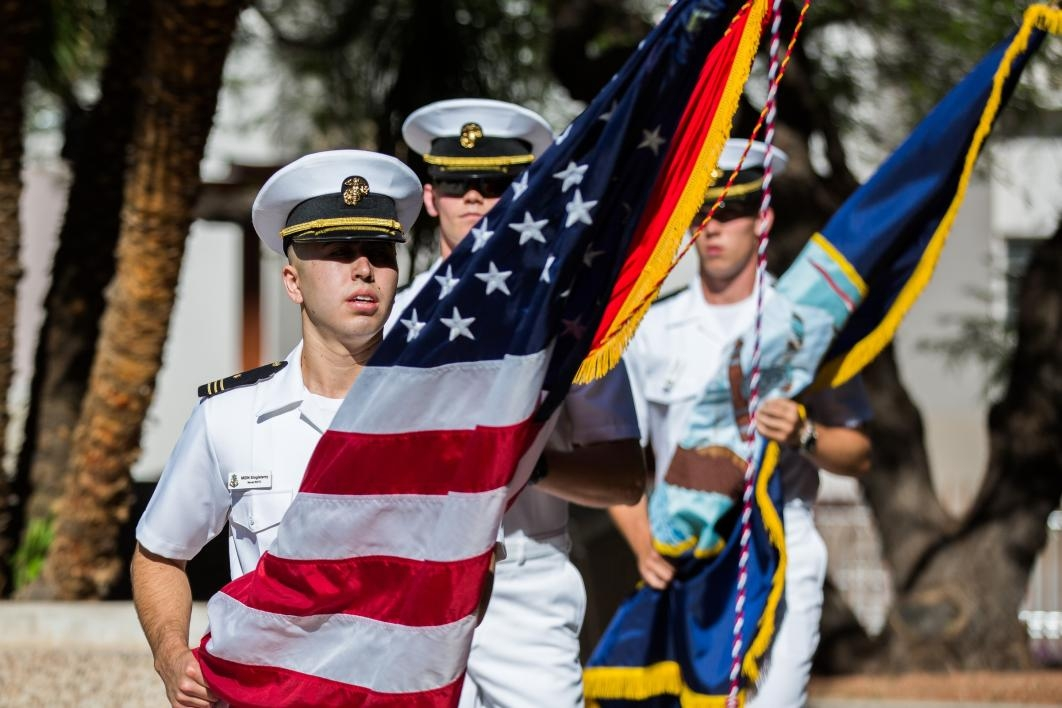 Naval cadets entering ceremony with flags