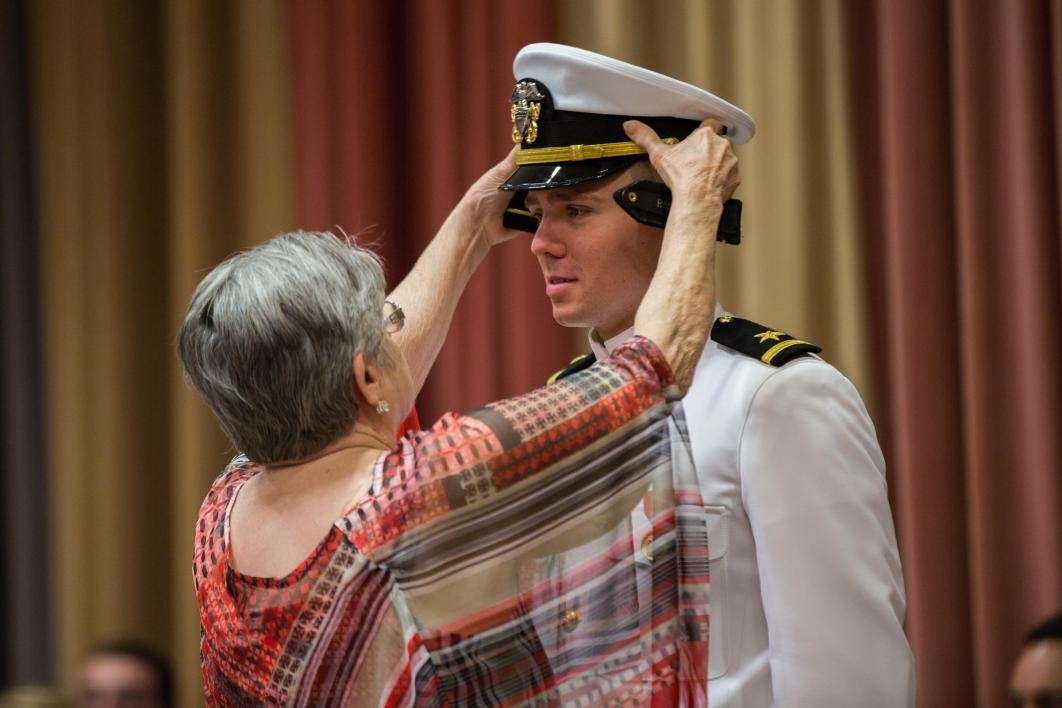 mom helping cadet adjust cap