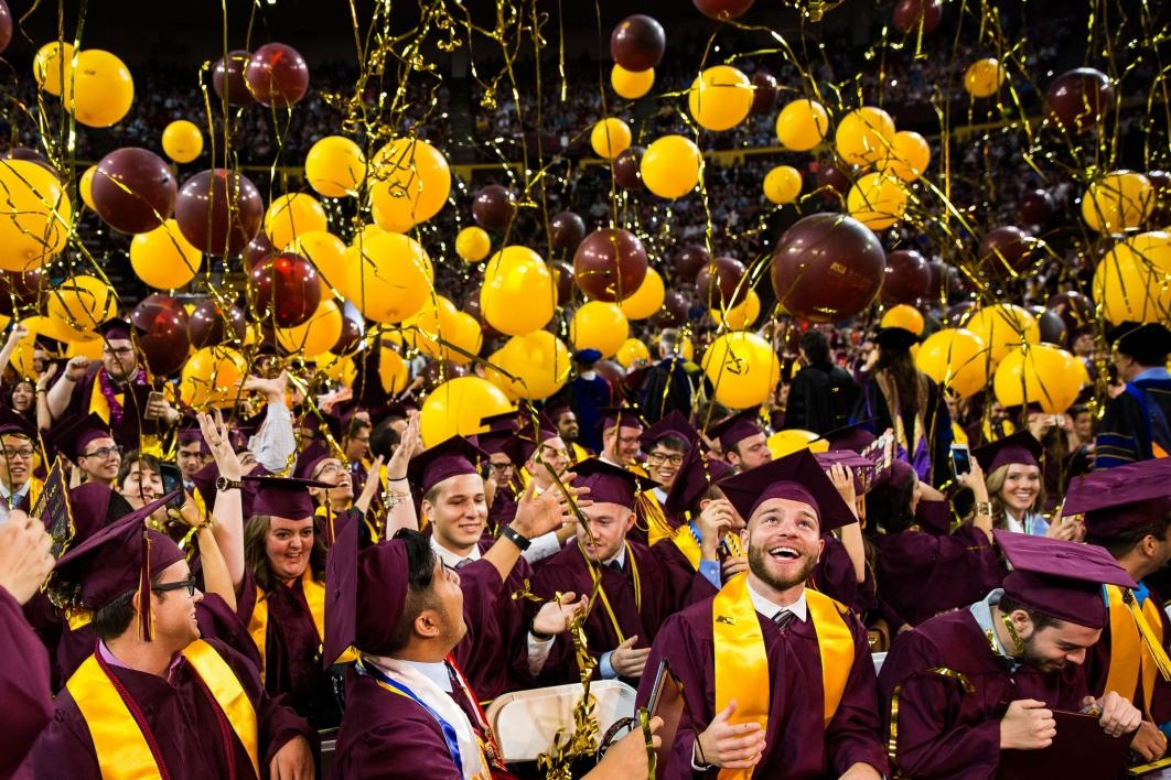 balloons dropping on graduates during convocation