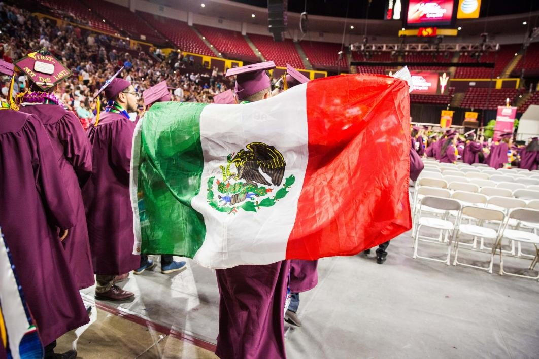 graduates entering Wells Fargo arena