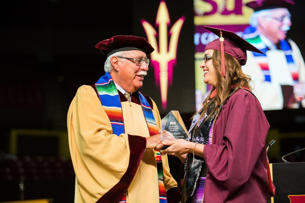 Ed Pastor shakes a new graduate's hand at the 2016 Hispanic Convocation