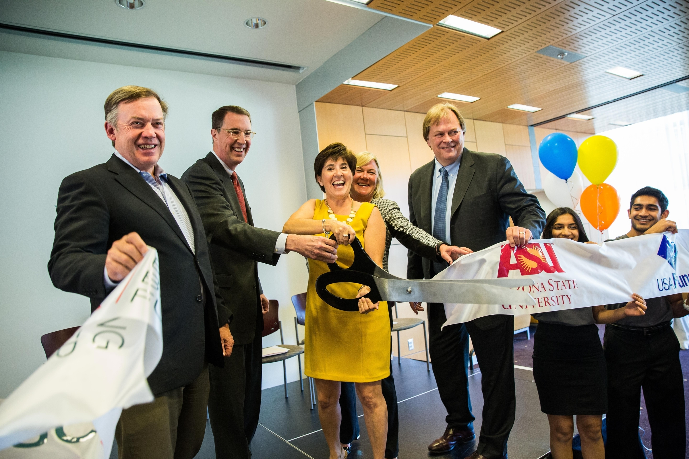 A ribbon-cutting at the PayPal-ASU partnership reception.