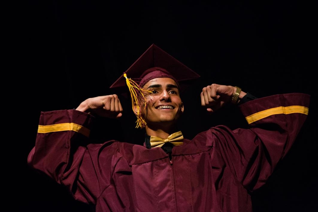 A student poses on stage during the ASU Prep-Phoenix commencement.