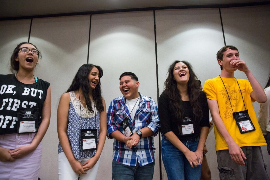 Students crack up while performing a vocal exercise at the Cesar E Chavez Leadership Institute
