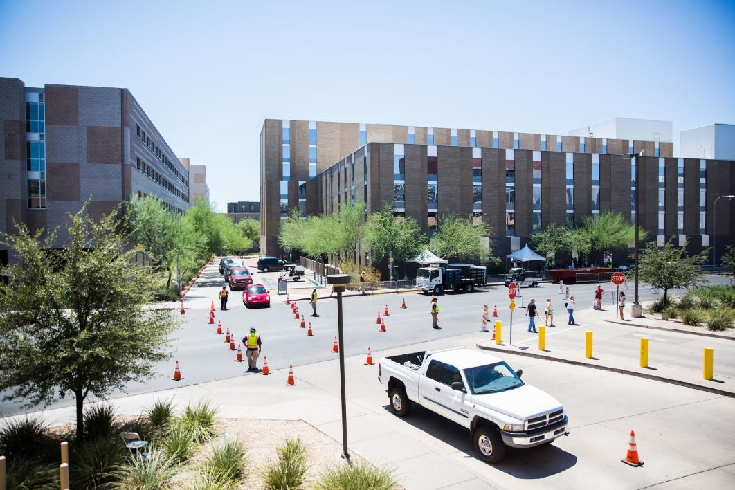 line of cars at move-in on campus