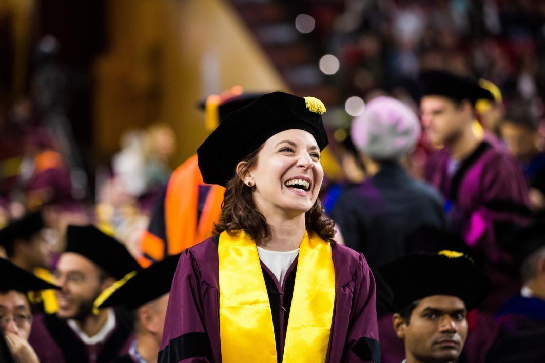 graduate laughing