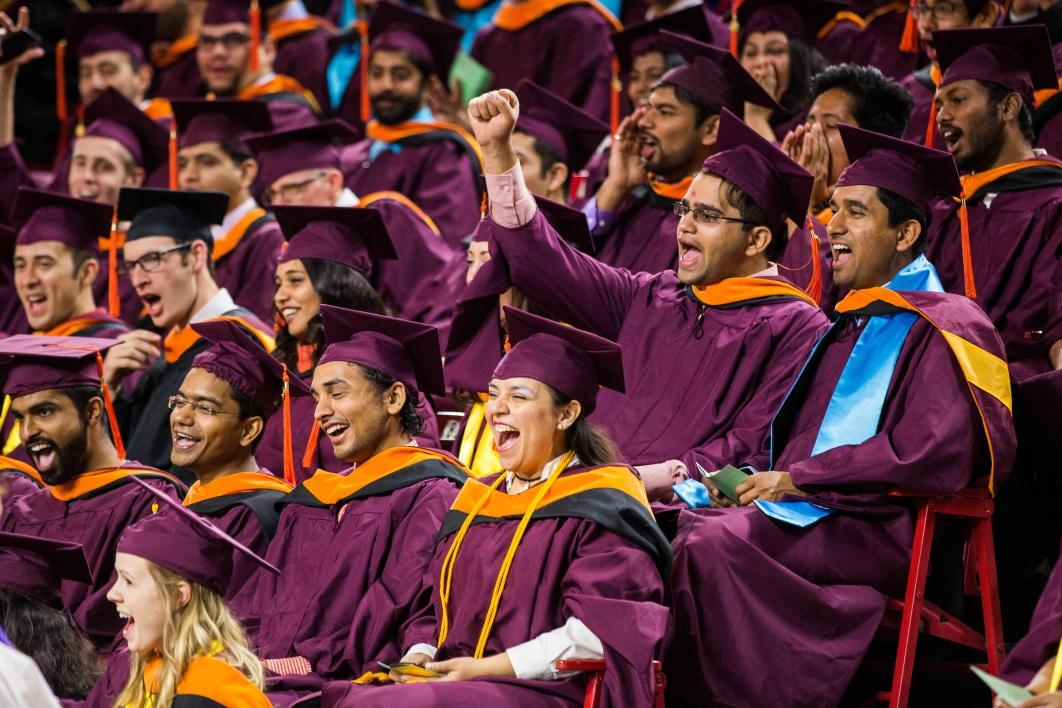 students cheering at graduation