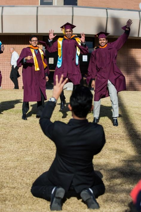 graduates pose for photo