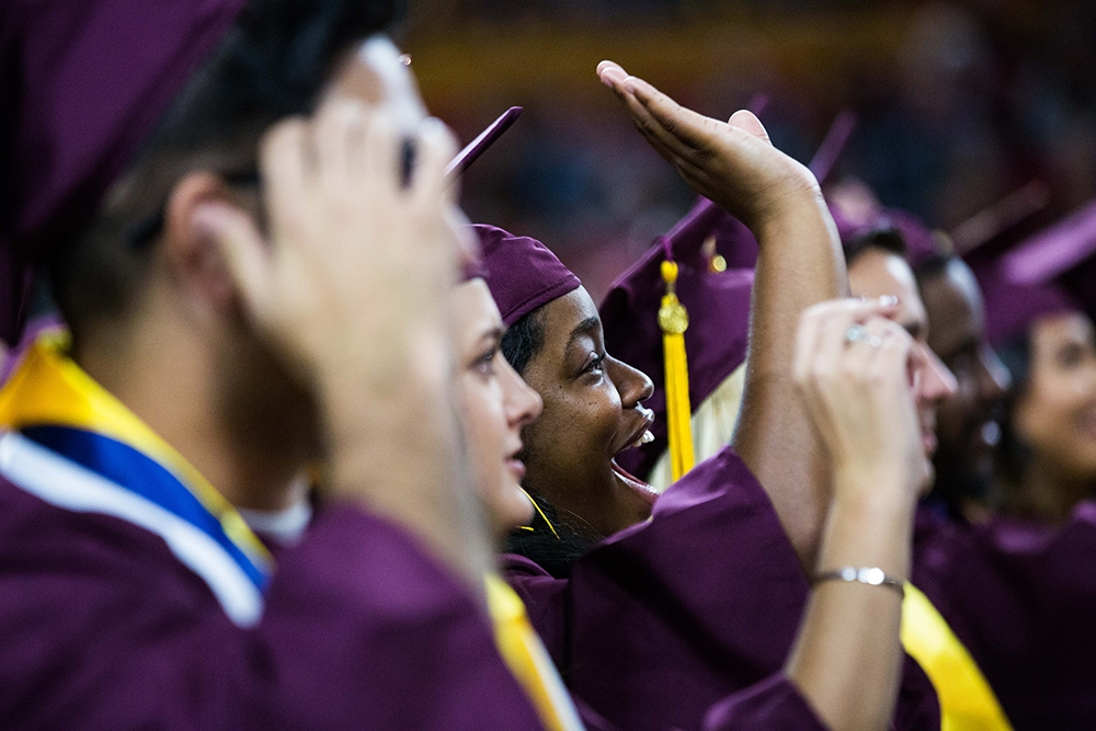 Grads wave to their families