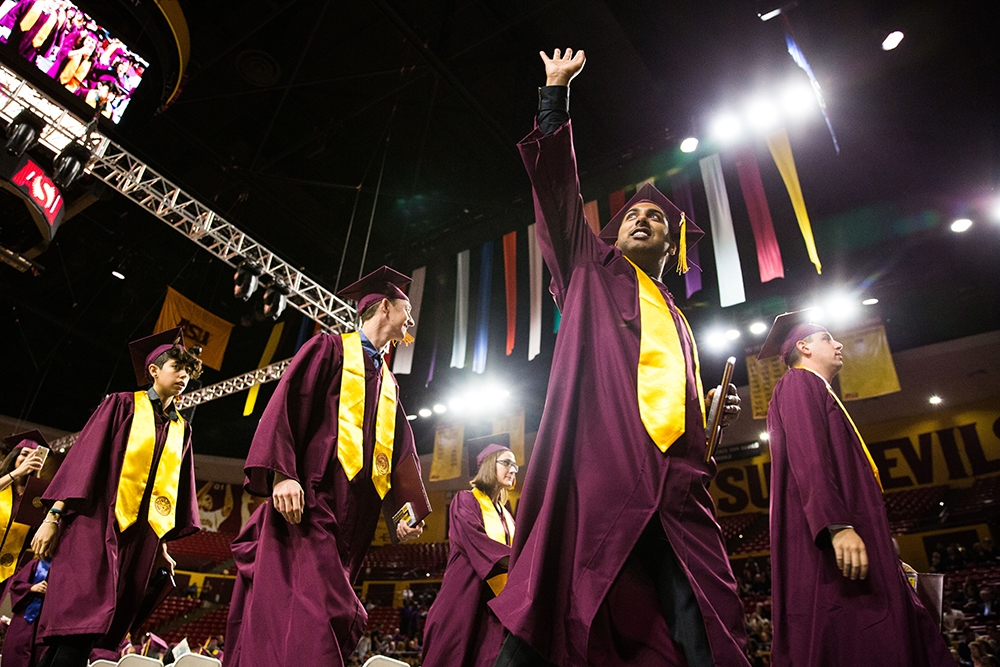 Grads leave the hall