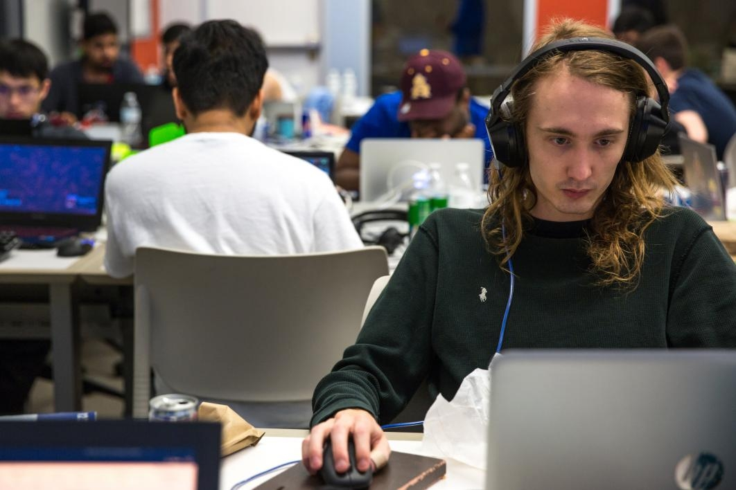 A student coder works during the hackathon