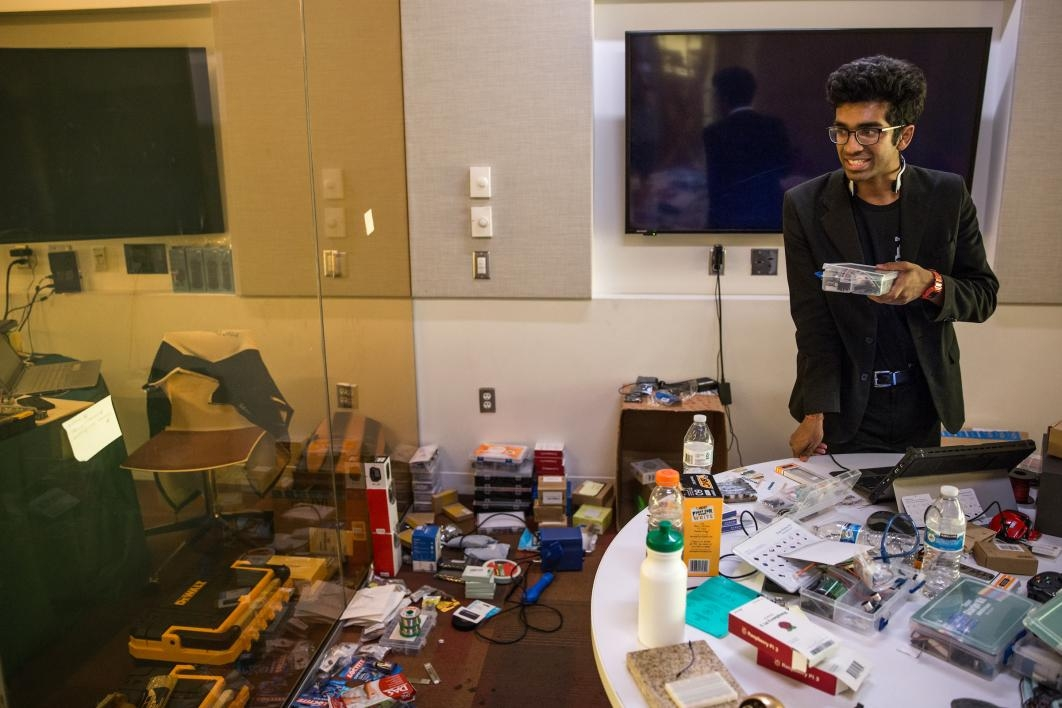 A staffer works the hardware-checkout room at the hackathon