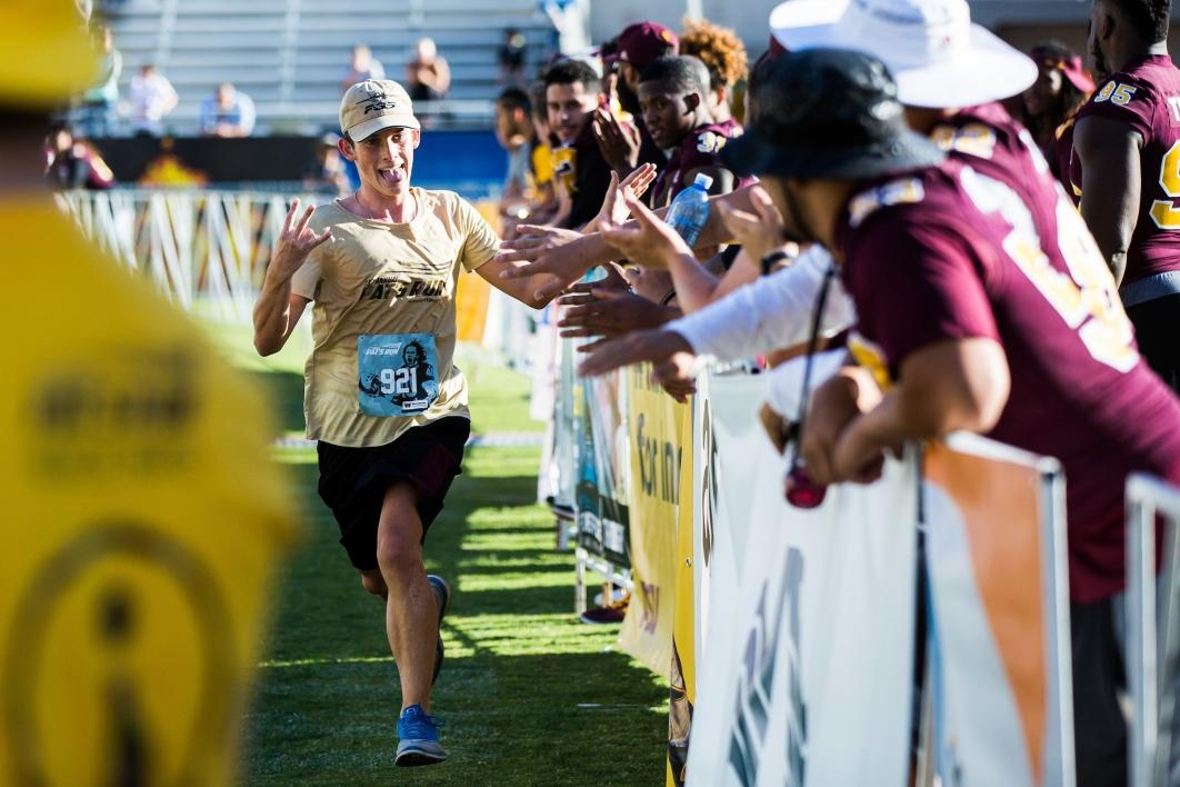 ASU football players greet runners as they finish Pat's Run