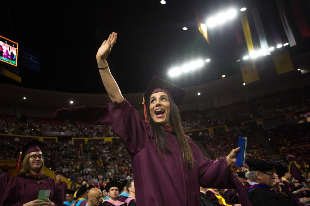 graduate waving