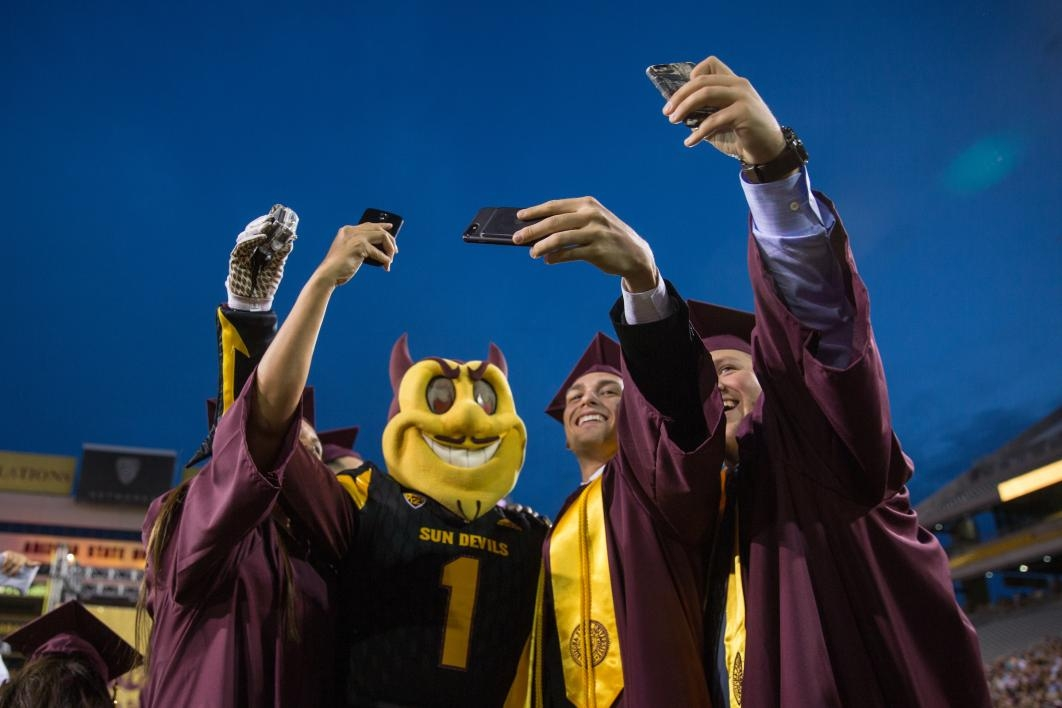grads taking selfie with Sparky