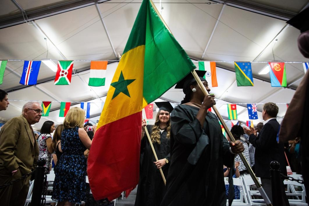Graduates carry flags at the Thunderbird School of Global Management commencement