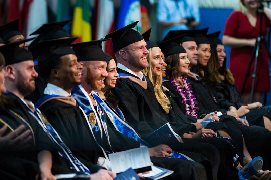 The audience laughs at the Thunderbird School of Global Management commencement