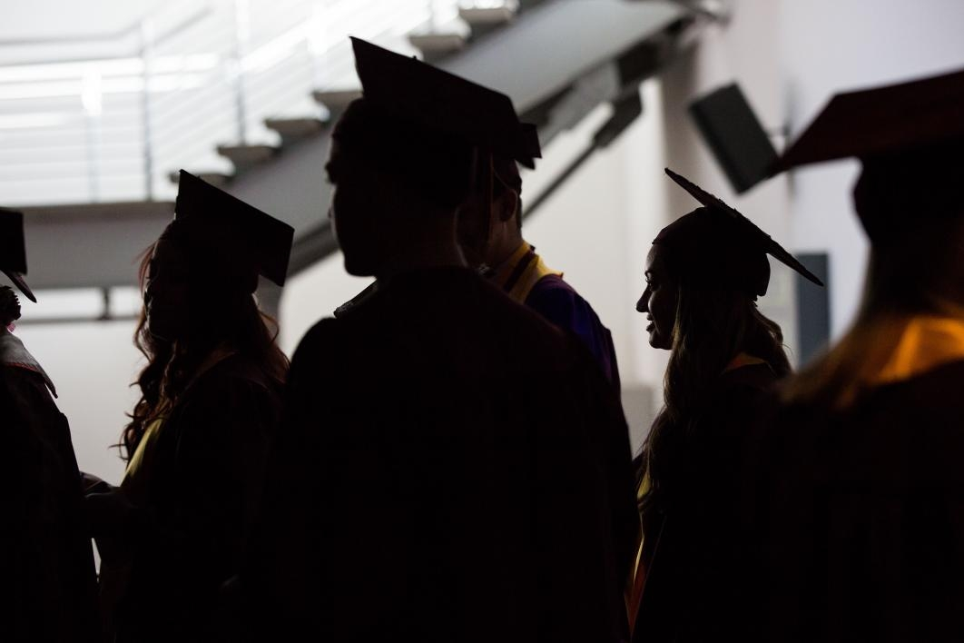 silhouette of graduates lined up