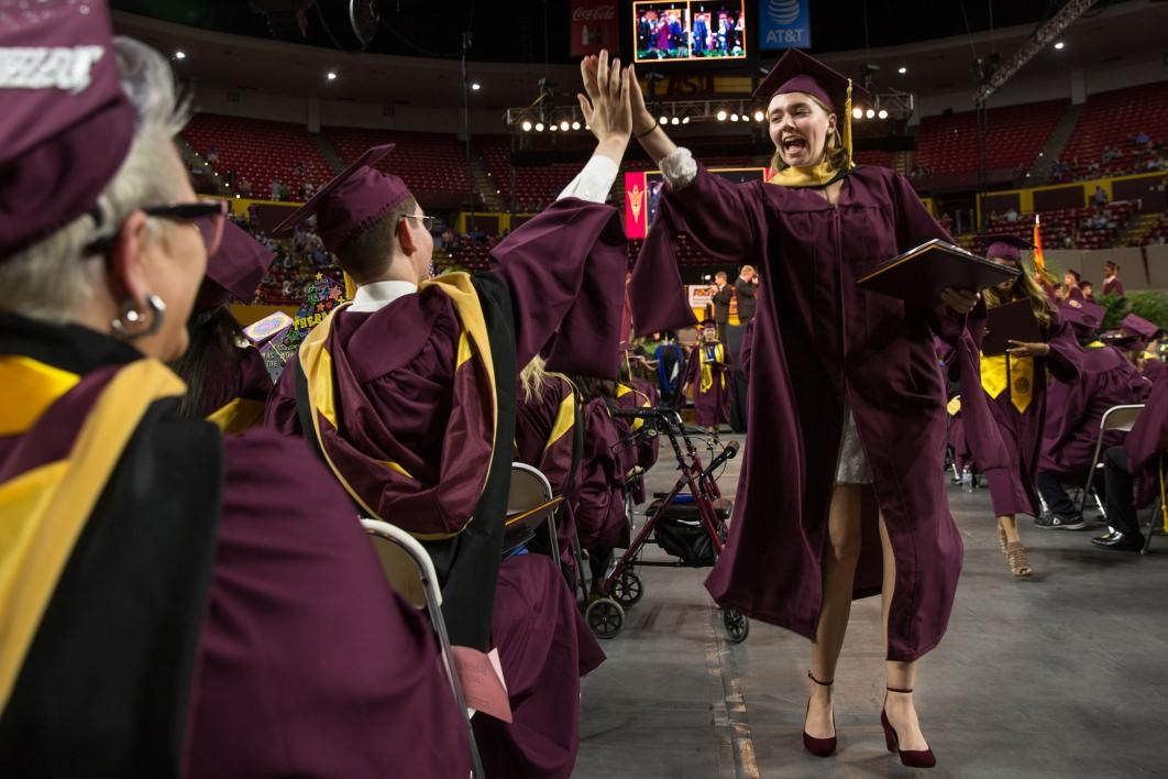 graduate high-fiving friend