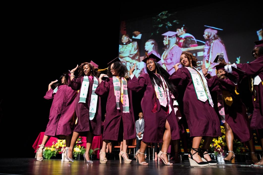 sorority members cross graduation stage together
