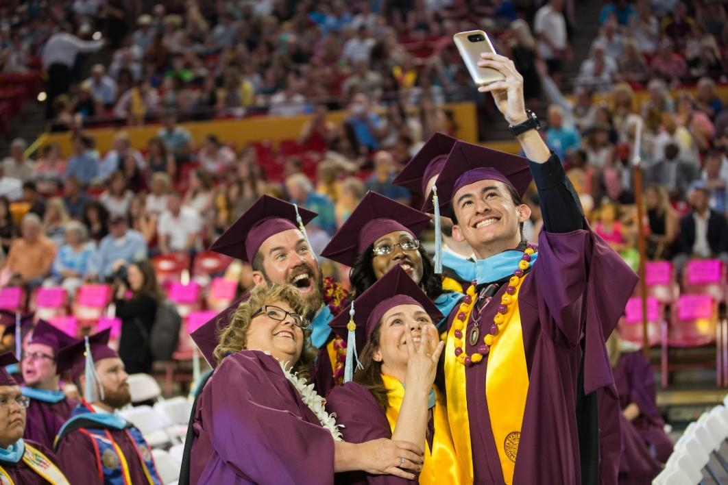 grads taking a selfie