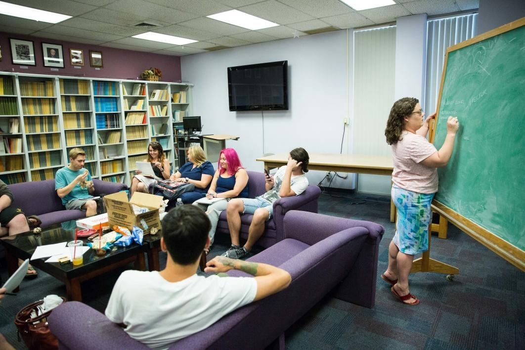 Participants look at a story during a creative writing workshop