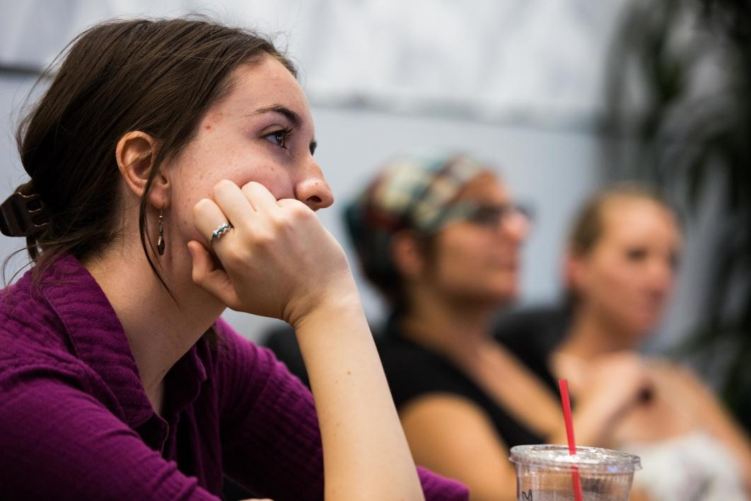 The audience listens to a reading at a writing workshop