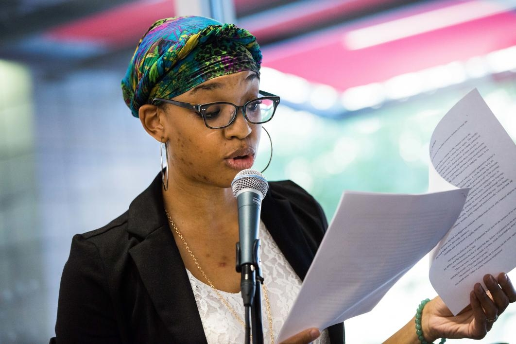 A writer reads her piece at a workshop