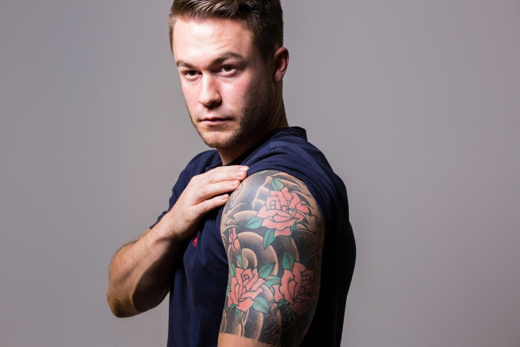portrait of man with Japanese tattoo on arm