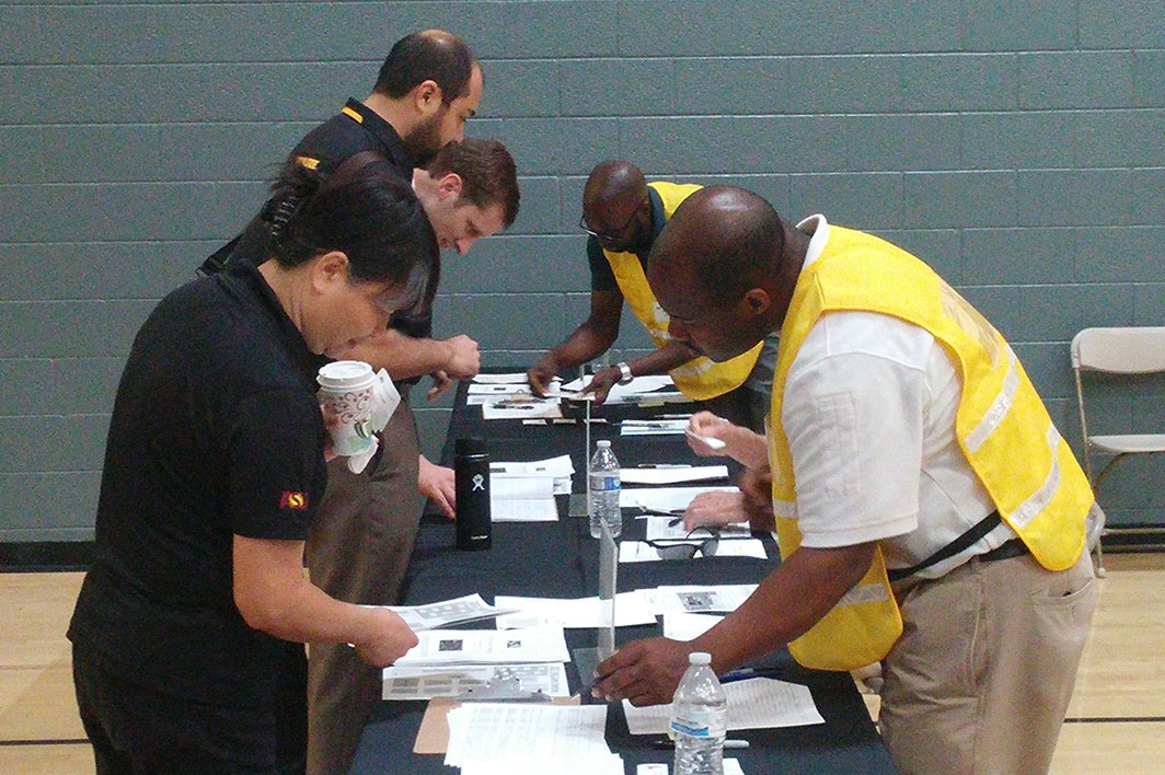 Team members check in for a cyberattack emergency drill in Tempe