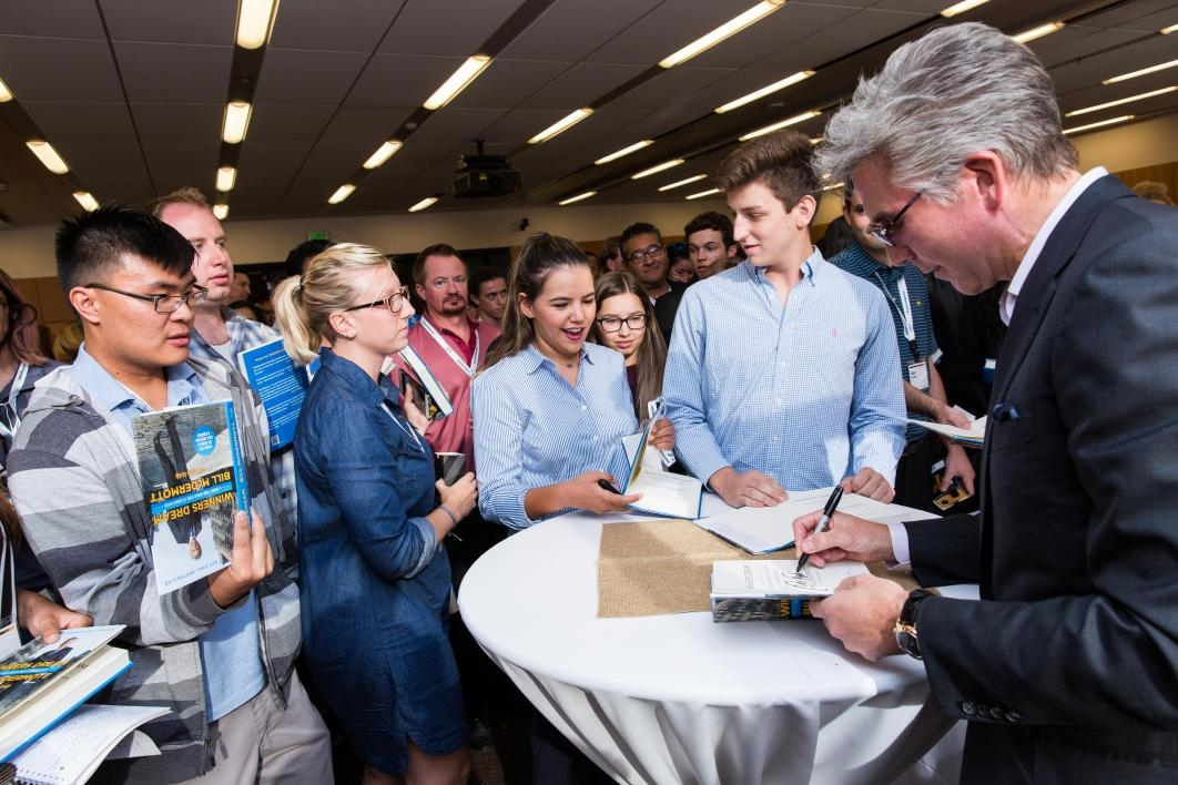 People gather to get autographs from SAP CEO Bill McDermott