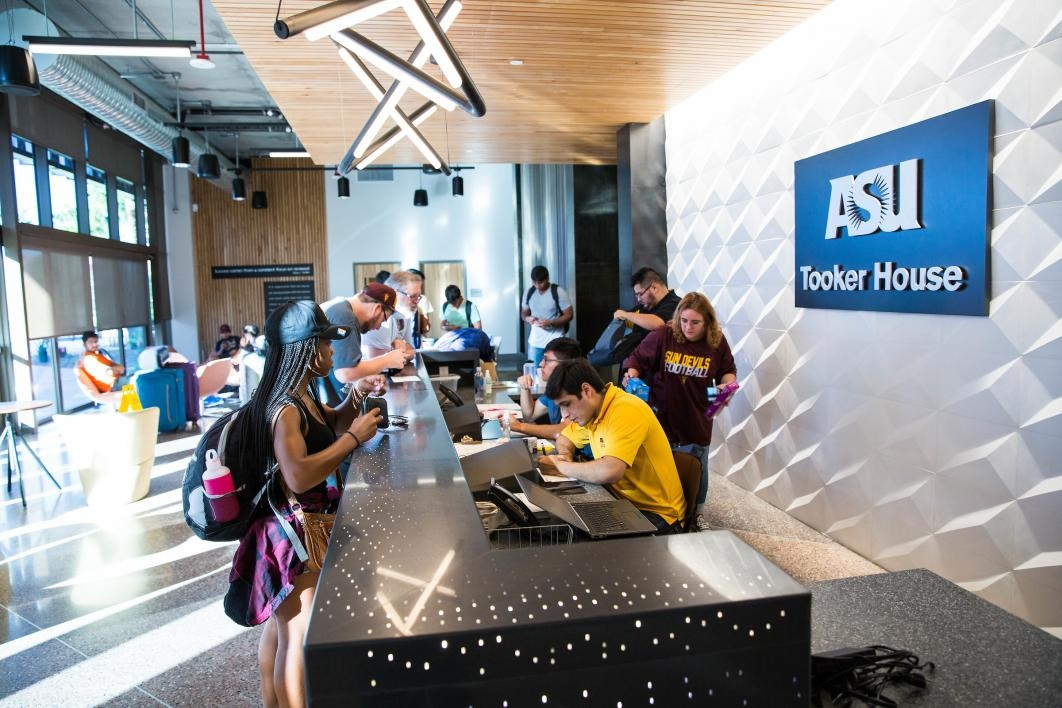 Students check in at the front desk of Tooker House
