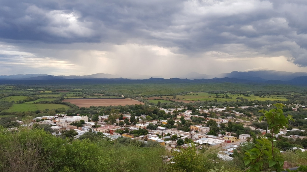The Mexican town of Rayon with a monsoon storm in the background.