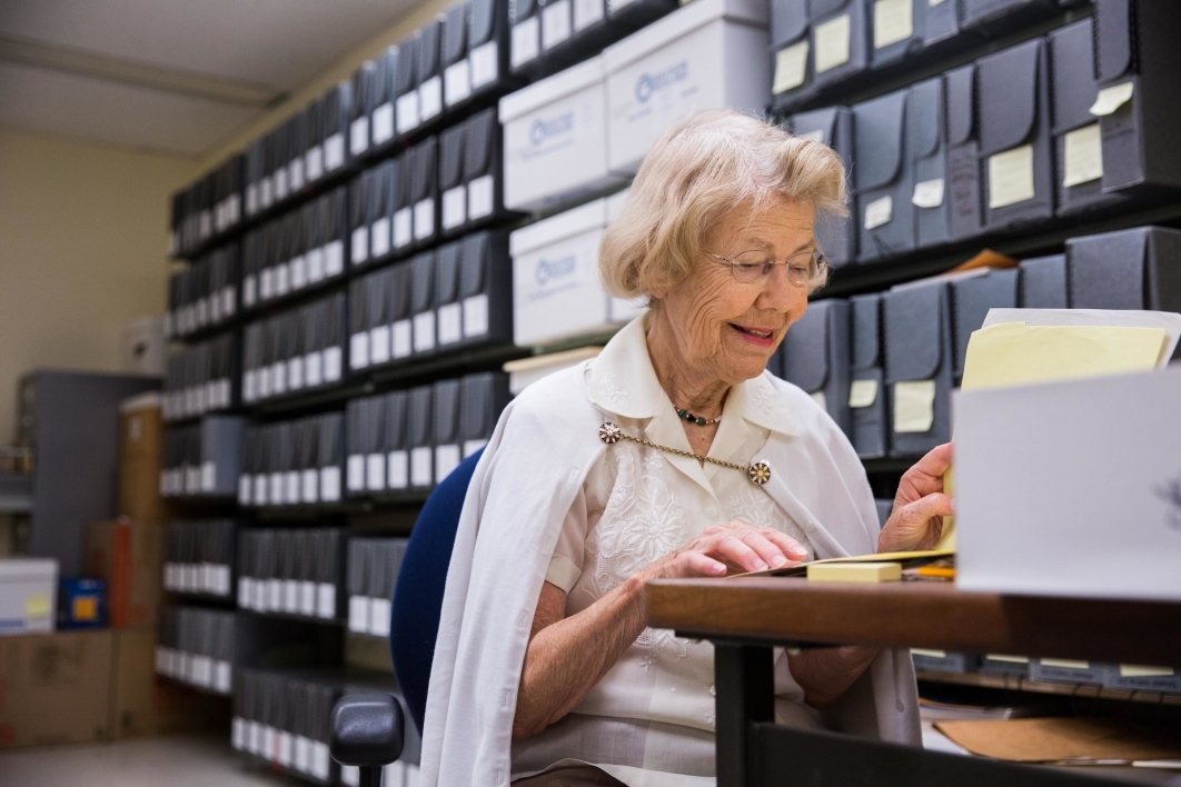 woman at desk in library collection