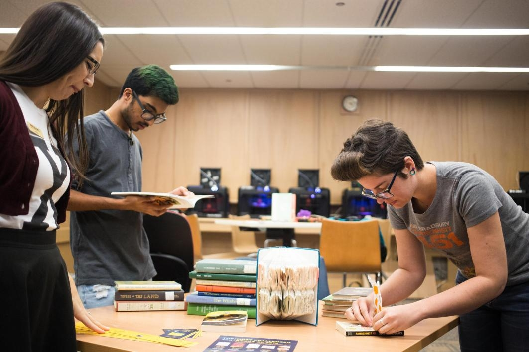 people working on book display