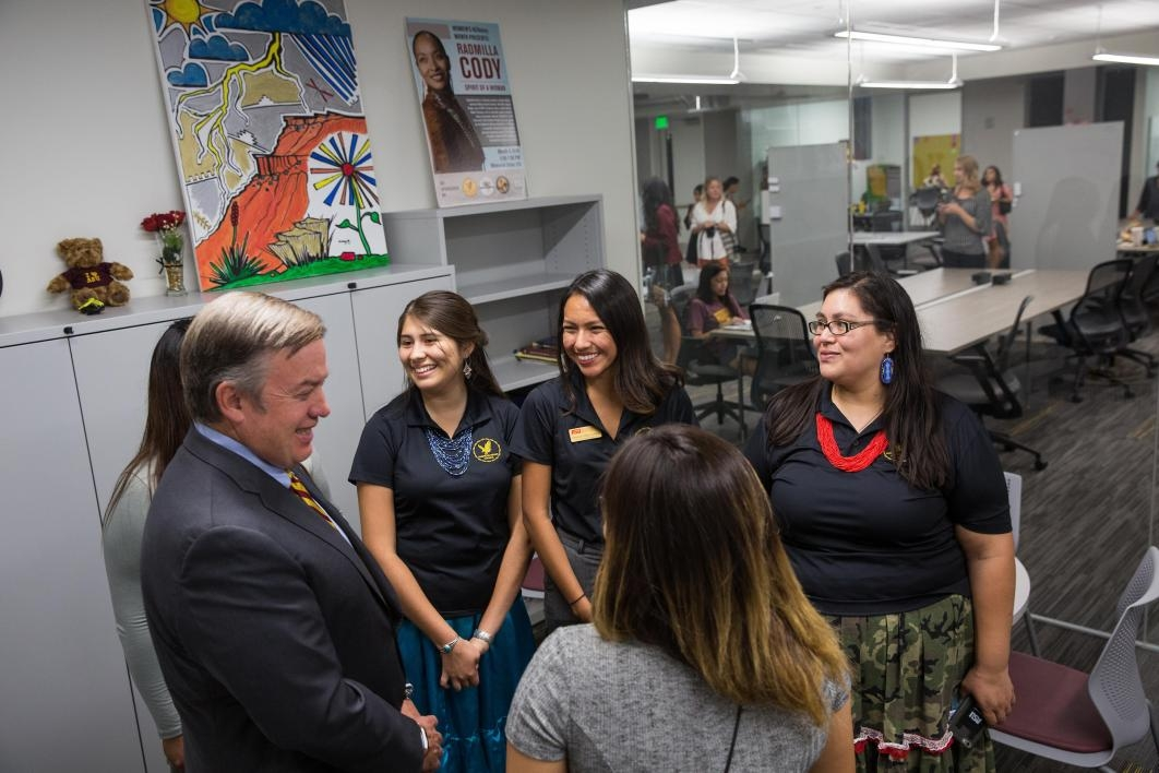 ASU President talking with students