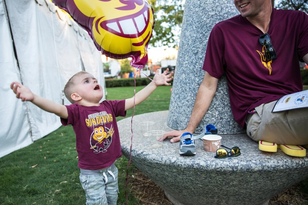 child playing with Sparky balloon