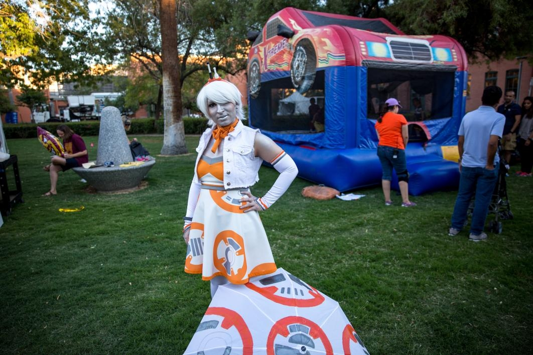 woman dressed as BB-8 charachter
