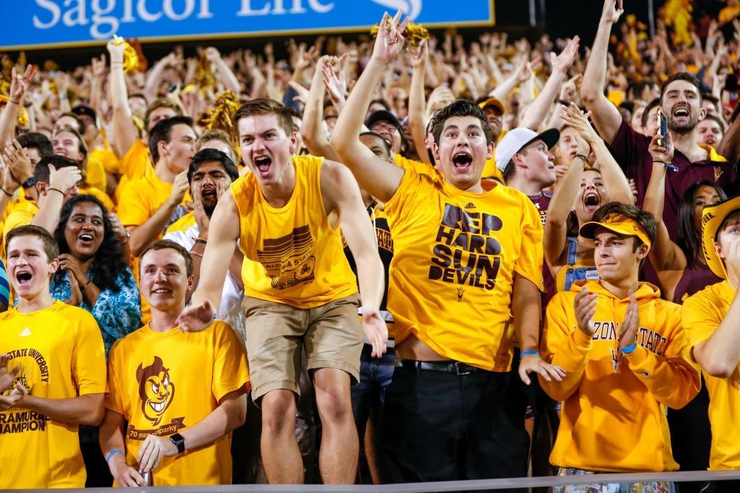 student cheering at football game