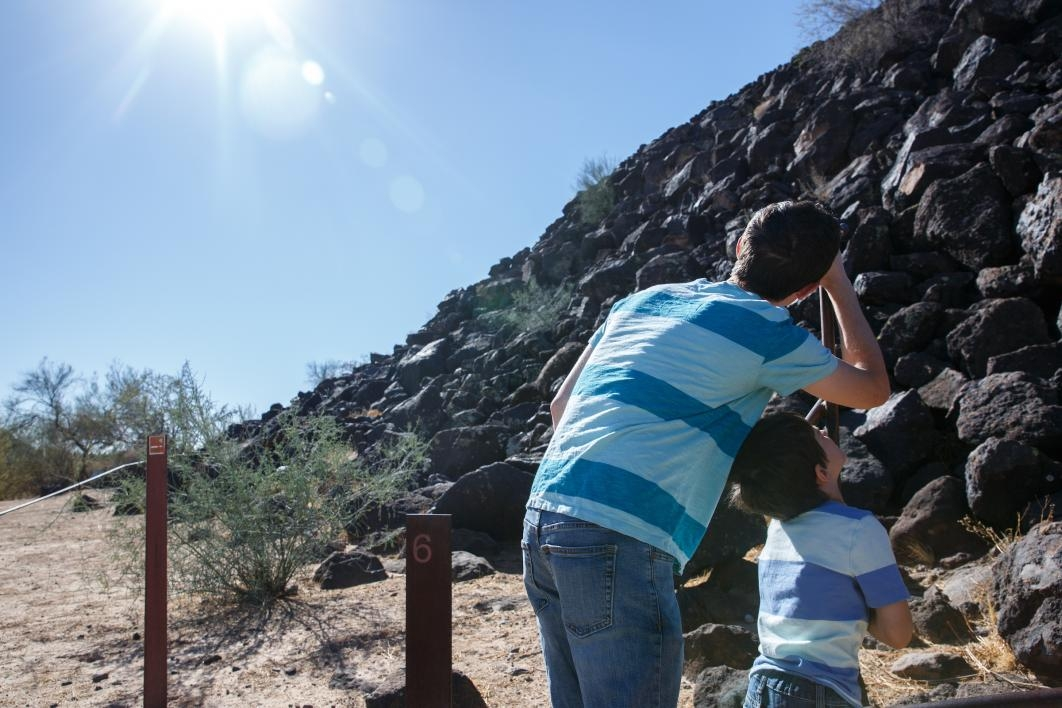 People look around the Deer Valley Petroglyph Preserve
