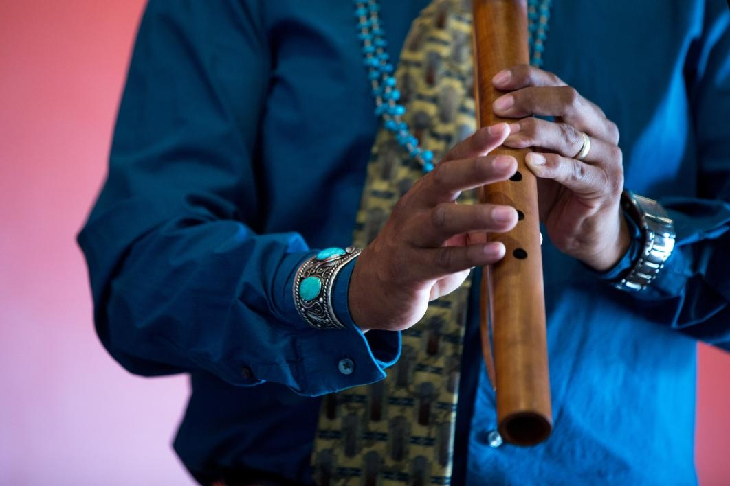 A man plays a Native American flute