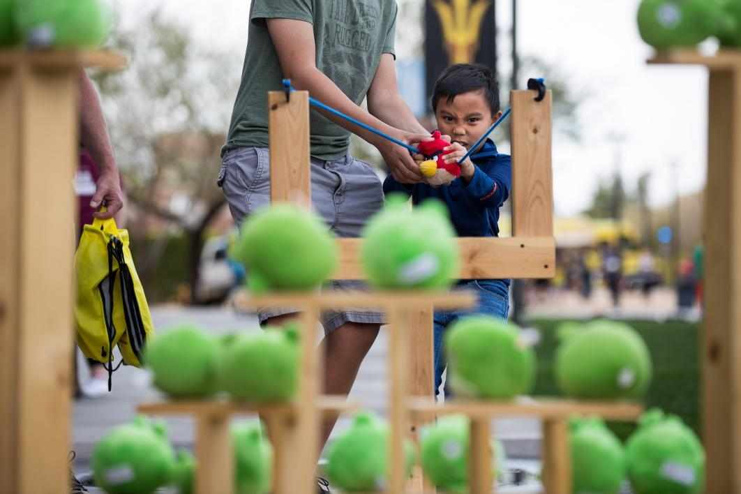 child playing with giant Angry Birds game