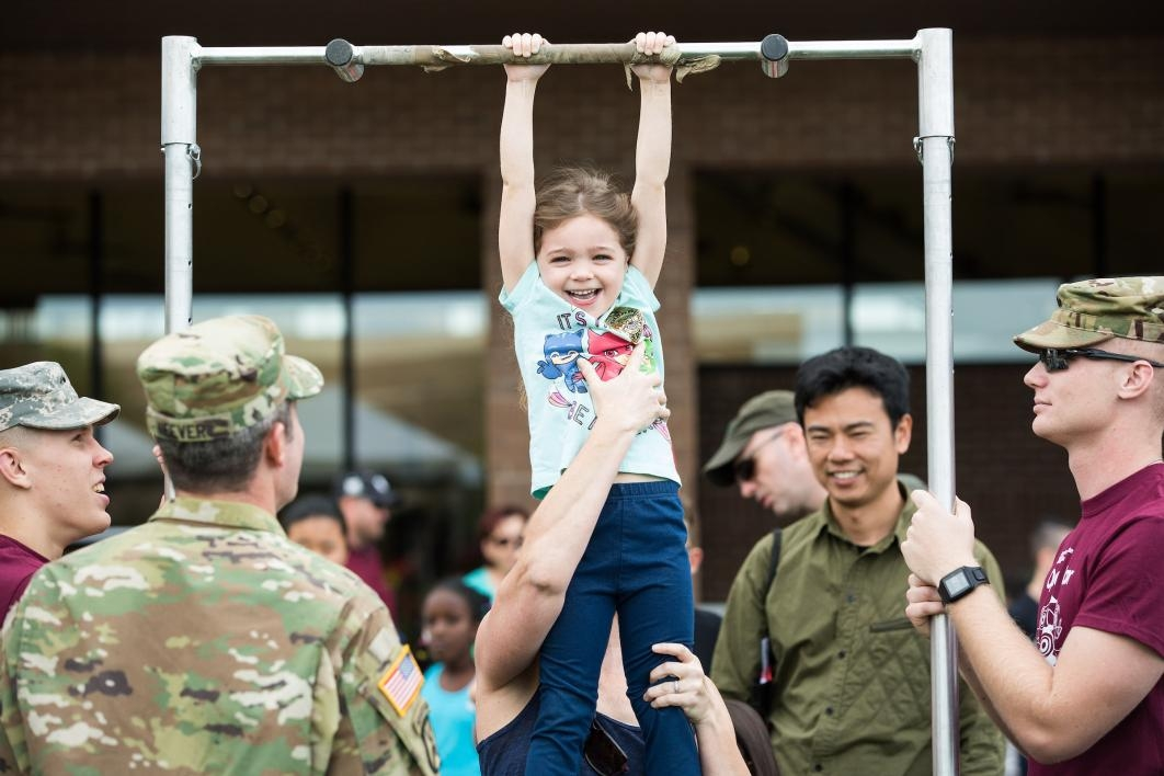 child practicing pull-ups