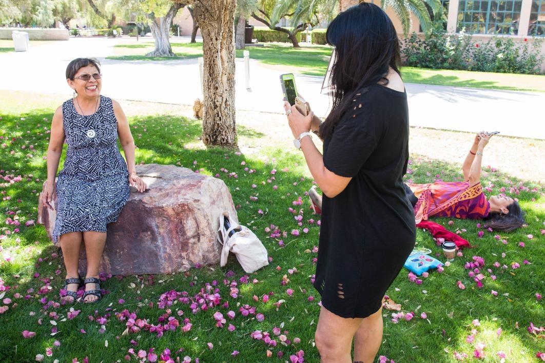 Two women taking selfies