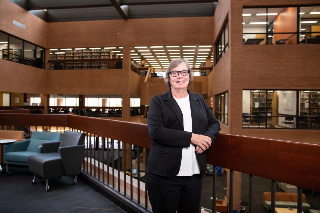 Associate University Librarian Tomalee Doan poses for a portrait in Noble Library