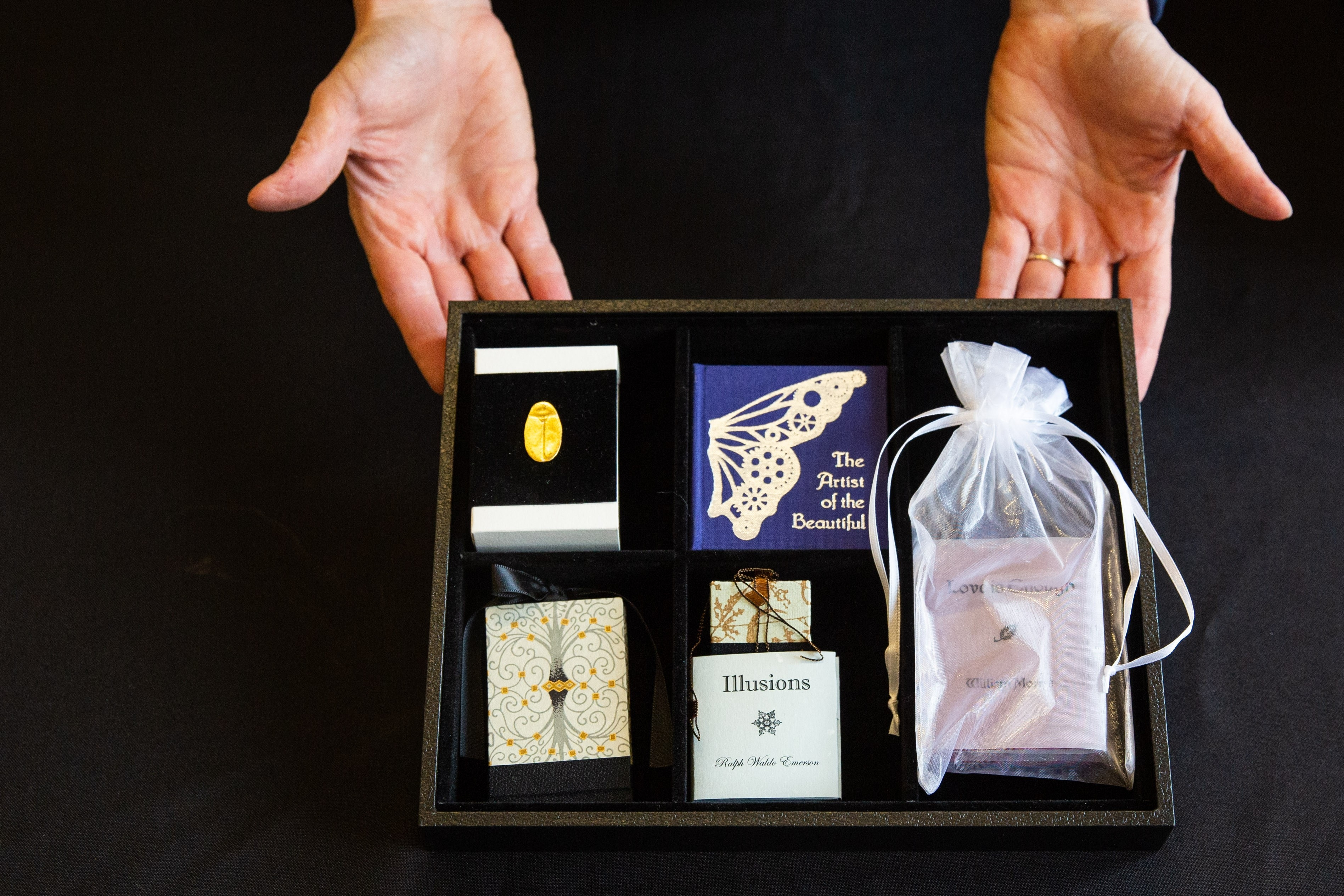A tray of miniature books by Kelly Houle / Photo by Deanna Dent/ASU Now