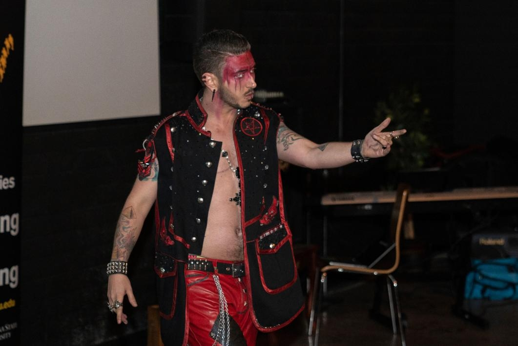 A drag king performs at a show