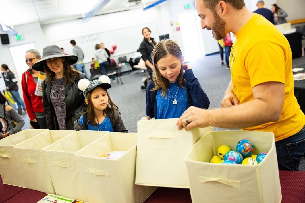 girls choosing prizes from a bin