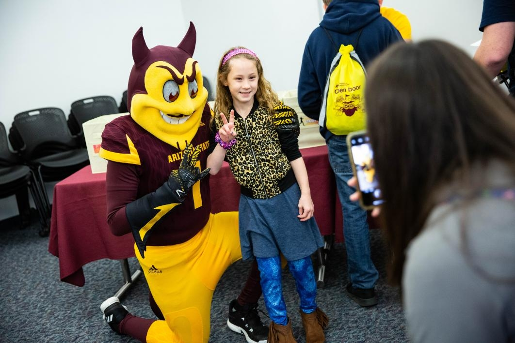 girl poses with sparky